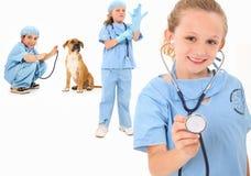 Vétérinaires de gosse photographie stock