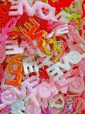 Vêtements à l'arrière-plan de mot d'amour Photographie stock