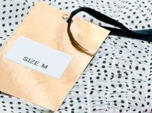 Vêtements avec le label. Images libres de droits
