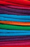 Vêtements colorés dans une pile Images stock