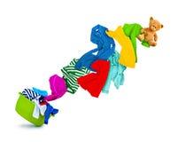 Vêtements colorés lumineux volant de la cuvette de lavage Image libre de droits