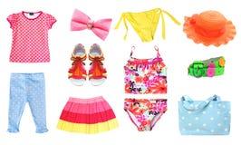 Vêtements d'été de fille d'enfant réglés d'isolement Photographie stock libre de droits