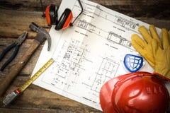 Vêtements de travail protecteurs de construction avec des plans image stock