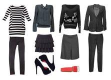 Vêtements femelles noirs réglés Collage d'habillement de femmes d'isolement photographie stock libre de droits