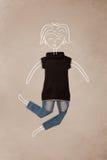 Vêtements placés dans l'action avec le dessin de femme Photo stock