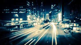 Vídeo borrado sumário do tráfego de cidade da noite Lapso de tempo Hon Kong vídeos de arquivo