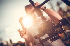 Vídeo da suspensão Cardan DSLR da câmera imagens de stock