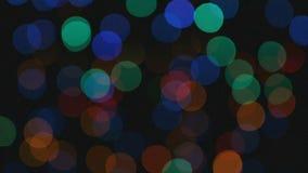 Vídeo de las luces del color con efecto del bokeh almacen de video