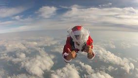 Vídeo del skydiver de Santa Claus metrajes