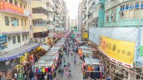 vídeo do timelapse 4k de um mercado de rua em Hong Kong filme