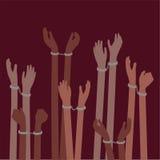 Vítimas dos prisioneiros ou dos escravos do tráfico com mãos nas algemas - conceito da liberdade Imagem de Stock Royalty Free
