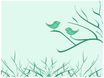 Vögel, die auf dem Zweig sitzen Lizenzfreies Stockfoto