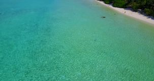 V06795 Aerial flying drone view of Maldives white sandy beach abstract waves water surface texture on sunny tropical stock video footage