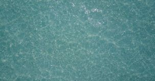V06923 Aerial flying drone view of Maldives white sandy beach abstract waves water surface texture on sunny tropical stock video