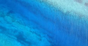 V06798 Aerial flying drone view of Maldives white sandy beach abstract waves water surface texture on sunny tropical stock video