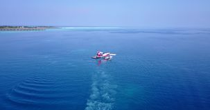 V06400 Aerial flying drone view of Maldives white sandy beach airplane seaplane sunny tropical paradise island with aqua Stock Photography