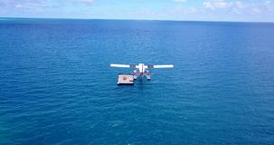 V06420 Aerial flying drone view of Maldives white sandy beach airplane seaplane sunny tropical paradise island with aqua Royalty Free Stock Photos