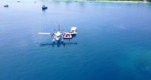 V06391 Aerial flying drone view of Maldives white sandy beach airplane seaplane sunny tropical paradise island with aqua Stock Photo