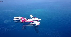 V06390 Aerial flying drone view of Maldives white sandy beach airplane seaplane sunny tropical paradise island with aqua Stock Photography