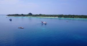 V06413 Aerial flying drone view of Maldives white sandy beach airplane seaplane sunny tropical paradise island with aqua Royalty Free Stock Photos