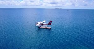 V06414 Aerial flying drone view of Maldives white sandy beach airplane seaplane sunny tropical paradise island with aqua Stock Photography