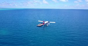 V06392 Aerial flying drone view of Maldives white sandy beach airplane seaplane sunny tropical paradise island with aqua. Aerial flying drone view of Maldives stock footage