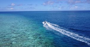 V06221 Aerial flying drone view of Maldives white sandy beach jetski riding sunny tropical paradise island with aqua Royalty Free Stock Images