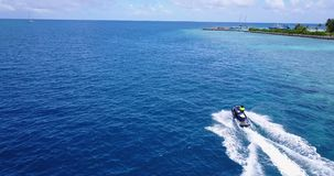 V06219 Aerial flying drone view of Maldives white sandy beach jetski riding sunny tropical paradise island with aqua stock video