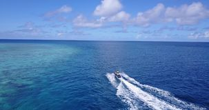 V06241 Aerial flying drone view of Maldives white sandy beach jetski riding sunny tropical paradise island with aqua stock video