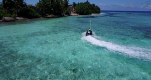 V06203 Aerial flying drone view of Maldives white sandy beach jetski riding sunny tropical paradise island with aqua stock footage