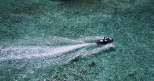 V06215 Aerial flying drone view of Maldives white sandy beach jetski riding sunny tropical paradise island with aqua stock video footage