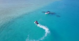 V06196 Aerial flying drone view of Maldives white sandy beach jetski riding sunny tropical paradise island with aqua stock footage