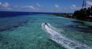 V06176 Aerial flying drone view of Maldives white sandy beach jetski riding sunny tropical paradise island with aqua stock video footage