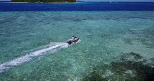 V06174 Aerial flying drone view of Maldives white sandy beach jetski riding sunny tropical paradise island with aqua stock footage