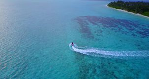 V06157 Aerial flying drone view of Maldives white sandy beach jetski riding sunny tropical paradise island with aqua stock video footage