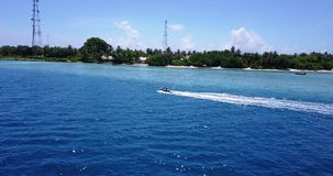 V06224 Aerial flying drone view of Maldives white sandy beach jetski riding sunny tropical paradise island with aqua stock video footage