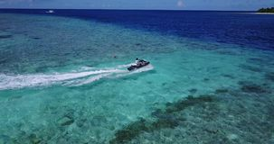 V06177 Aerial flying drone view of Maldives white sandy beach jetski riding sunny tropical paradise island with aqua stock video footage