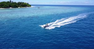 V06225 Aerial flying drone view of Maldives white sandy beach jetski riding sunny tropical paradise island with aqua stock video