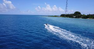 V06223 Aerial flying drone view of Maldives white sandy beach jetski riding sunny tropical paradise island with aqua stock footage