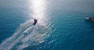 V06159 Aerial flying drone view of Maldives white sandy beach jetski riding sunny tropical paradise island with aqua stock video footage