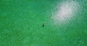 V06245 Aerial flying drone view of Maldives white sandy beach jetski riding sunny tropical paradise island with aqua stock footage