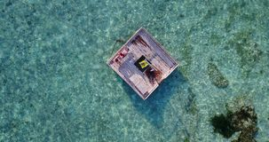 V03822 Aerial flying drone view of Maldives white sandy beach 2 people young couple man woman relaxing on sunny tropical Royalty Free Stock Image