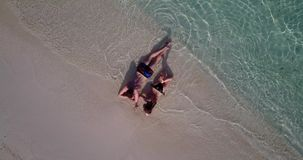V03997 Aerial flying drone view of Maldives white sandy beach 2 people young couple man woman romantic love on sunny stock video