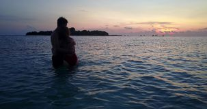 V04154 Aerial flying drone view of Maldives white sandy beach 2 people young couple man woman romantic love sunset Royalty Free Stock Photos