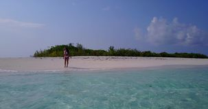 V06289 Aerial flying drone view of Maldives white sandy beach 1 person young beautiful lady on sandbar on sunny tropical Royalty Free Stock Photo