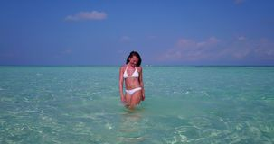 V06301 Aerial flying drone view of Maldives white sandy beach 1 person young beautiful lady splashing playing on sunny Royalty Free Stock Image