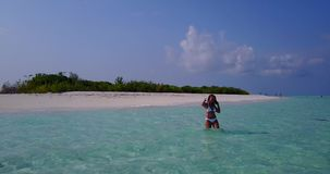 V06297 Aerial flying drone view of Maldives white sandy beach 1 person young beautiful lady splashing playing on sunny Stock Photos
