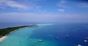 V06102 Aerial flying drone view of Maldives white sandy beach on sunny tropical paradise island with aqua blue sky sea stock video