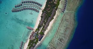 V03650 Aerial flying drone view of Maldives white sandy beach on sunny tropical paradise island with aqua blue sky sea Stock Photography