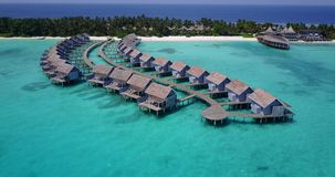 V03593 Aerial flying drone view of Maldives white sandy beach on sunny tropical paradise island with aqua blue sky sea Stock Photography